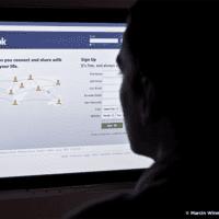 Woman looking at the Facebook Login scree