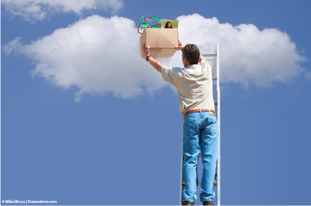 Man putting box of possessions into the cloud