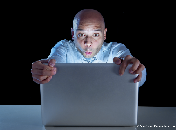 Man staring at computer with mouth wide open