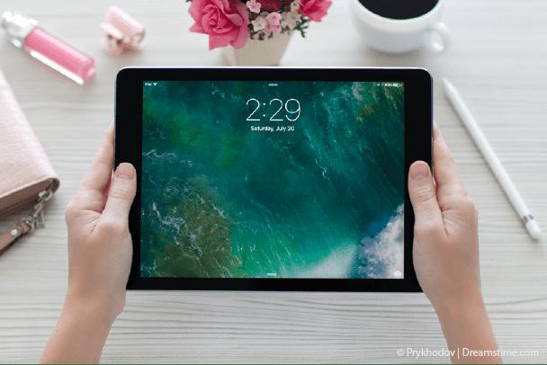 Woman holding iPad pro