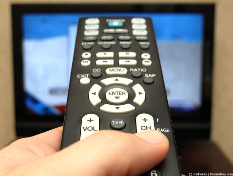 TV remote control pointing at screen