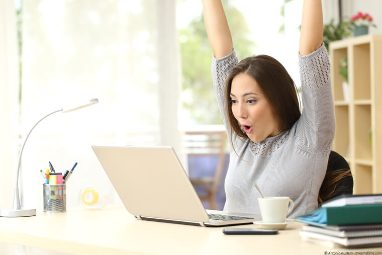 Women gambling on laptop and cheering