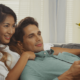 Japanese female and white male watching TV