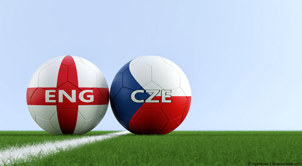 Two footballs on field, one with ENG and the other with CZE