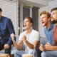 Group of males watching boxing and cheering