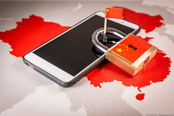 Mobile phone on map of China with flag and padlock