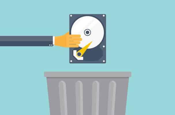 Hand dropping hard drive in a bin