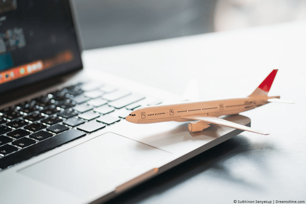 Model airplane sat on laptop