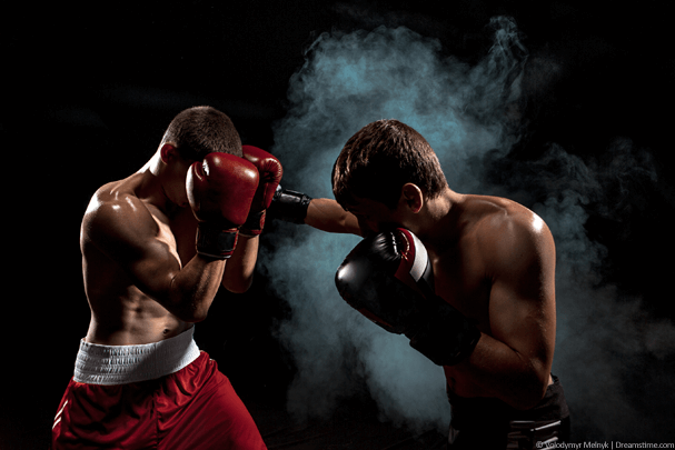 Two boxers fighting with smokey background