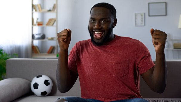 African man watching AFCON football