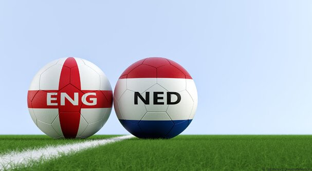 Two footballs with England and Netherlands flags on