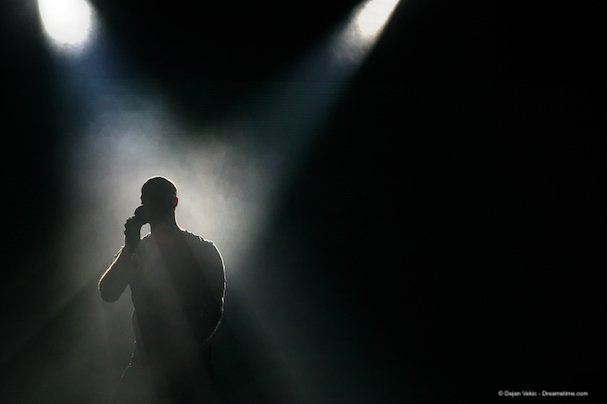 A singer silhouetted in spotlights