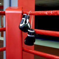 Boxing gloves in a boxing ring