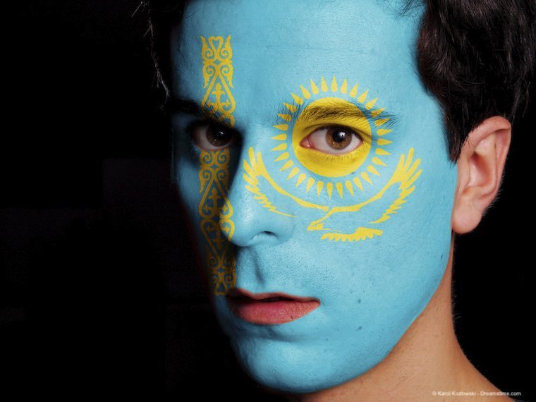 Flag of Kazakhstan Painted on a Face of a Young Man