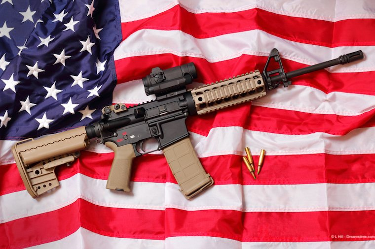 A high-powered assault rifle on the US flag.