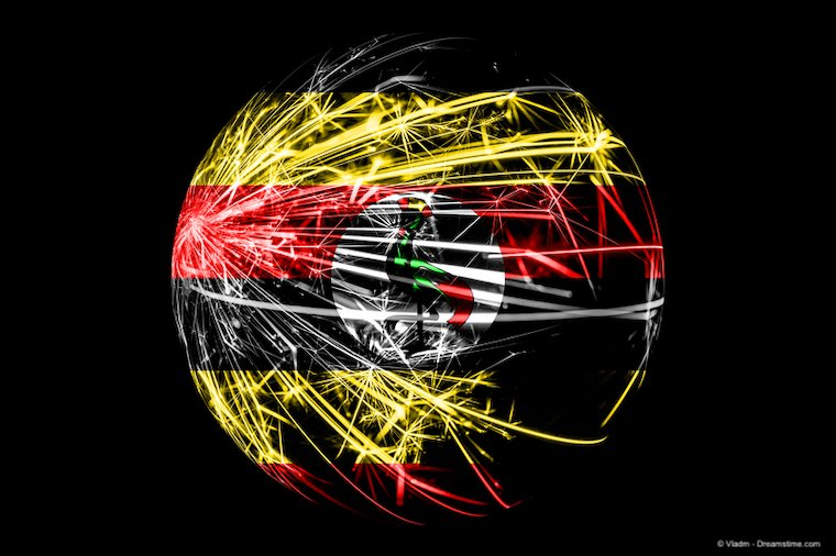 Abstract image of Ugandan flag as a ball made of sparks