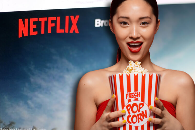 Korean woman holding popcorn over Netflix sign