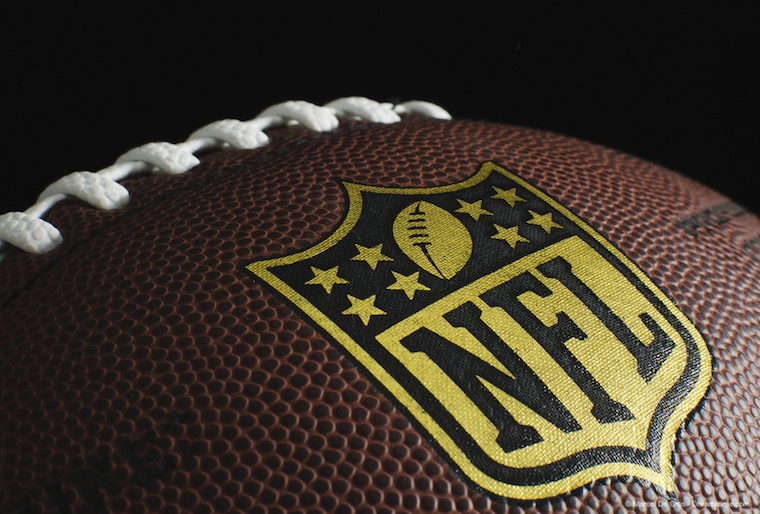NFL logo on close-up of an American Football