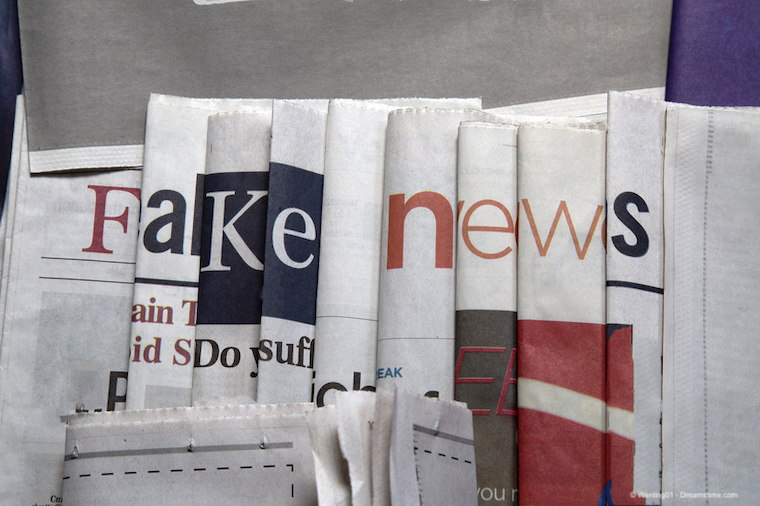 A selection of newspapers spelling out the term fake news in their headlines