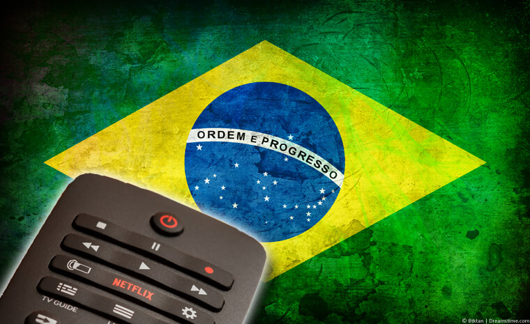 Brazilian flag with TV remote showing Netflix button