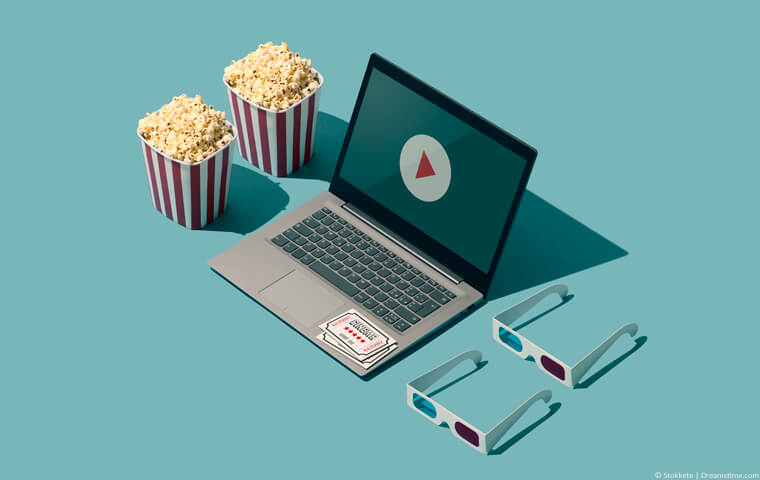 Laptop with popcorn and 3D glasses
