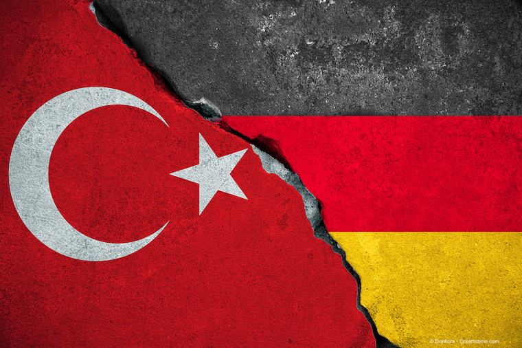 red turkey flag on broken damage brick wall and half germany flag background