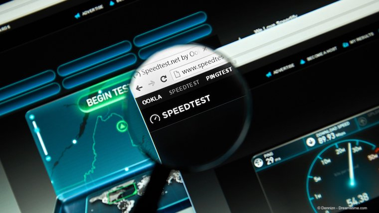 Ookla's speedtest website with magnifying glass closeup.