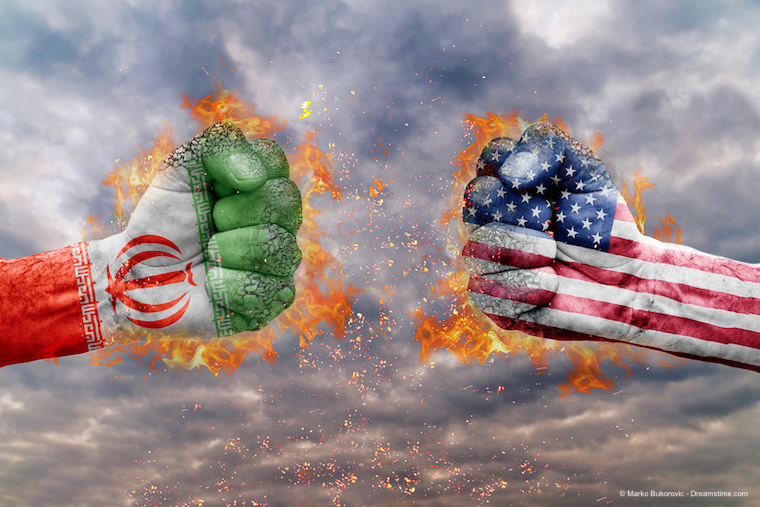 Two fist with the flag of Iran and USA faced at each other ready for fight