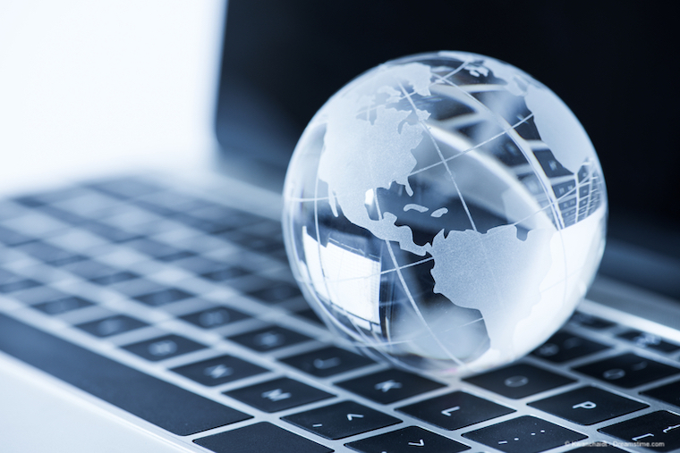 glass globe on laptop computer background