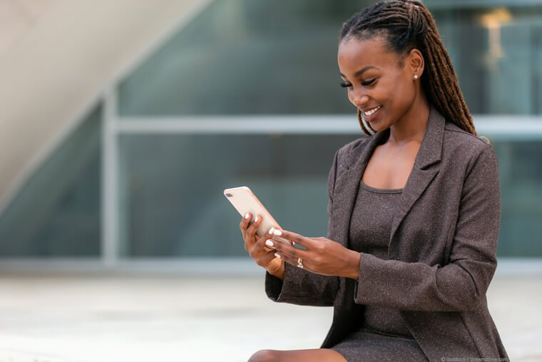 African businesswoman holding phone