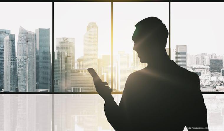 Man using smartphone in Singapore