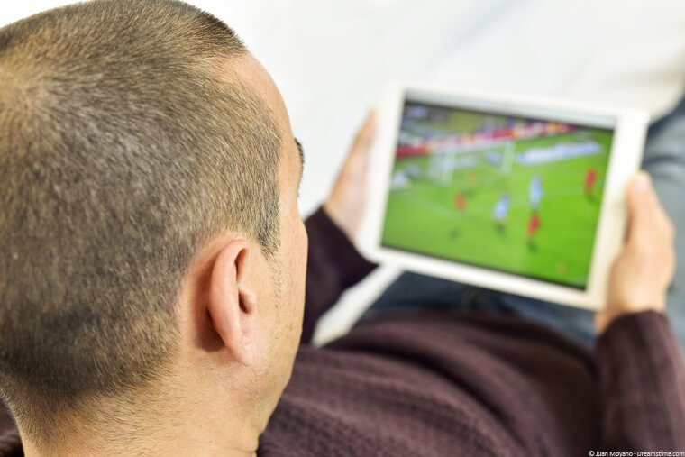 Man watching football on a tablet