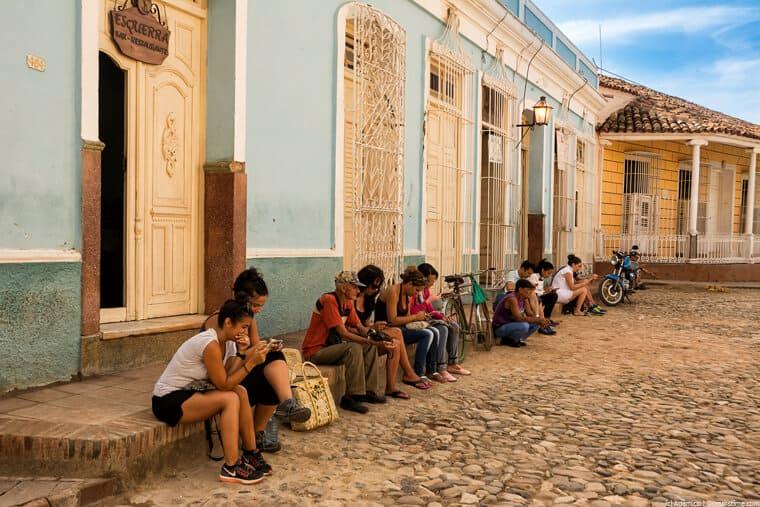 Cubans using a public wi-fi hotspot